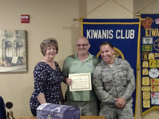 Gail Jay, of the Kiwanis Club of Greater Abilene, presents
