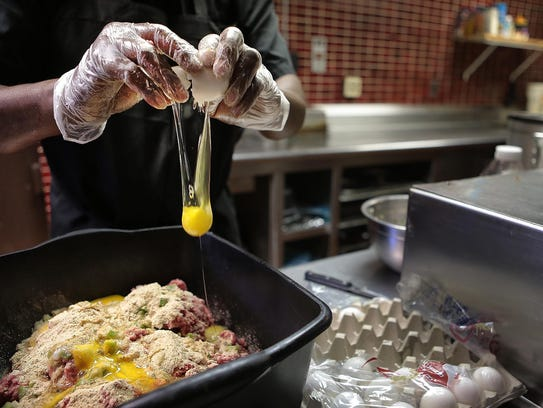Mike Leach makes a pan of meatloaf at the Leach Family