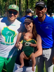 Neal Dubisky, left, his wife Chelsea and their 3-month-old son, Paxton, scored a photo with Aaron Rodgers at the American Century Championship.