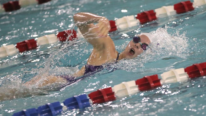 Lexington's Liv Merkel competes in the 200 freestyle against Wooster at the Friendly House on Thursday night.