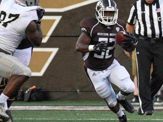 Western Michigan RB Jamauri Bogan (32) rushes for positive yards during first quarter of play Saturday night.