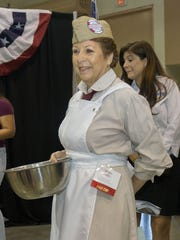 Deanna Young dressed like the doughnut women from World War I and offered doughnuts to the crowd.