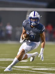St. Xavier's Jared Kreimer looks for some running room after making a first half reception against LaSalle Friday, October 6th at St. Xavier High School