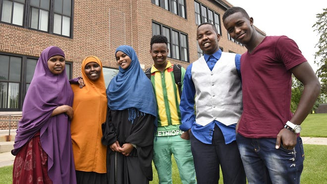 Somali students stand in front of their school following a group meeting of Somali students on May 28 at Tech High School.
