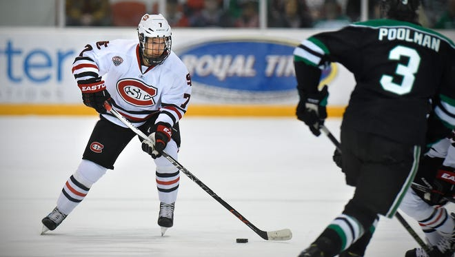 St. Cloud State defenseman Niklas Nevalainen (7) skates with the puck Saturday against North Dakota at the Herb Brooks National Hockey Center. Nevalainen is the reigning NCHC Defenseman of the Week.