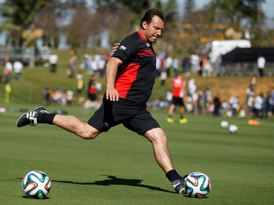 Belgium's head coach Marc Wilmots kicks a ball during a team training session in Mogi Das Cruzes, Brazil, Friday, June 13, 2014. Belgium plays in group H of the 2014 soccer World Cup. (AP Photo/Andrew Medichni)