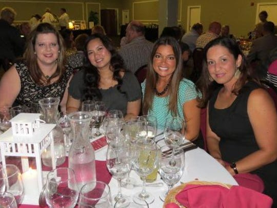 """Nicole Kiggans, Aileen Ilano, Michelle Roberts and Peggy Woy at the 2016 """"Wine a Little, Dine a Lot"""" fundraiser for Capstone Adaptive Learning Centers."""