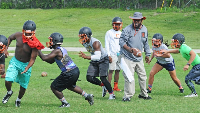 Cocoa High's Tigers got started early on Monday. State rules require them to practice in helmets only until Wednesday.