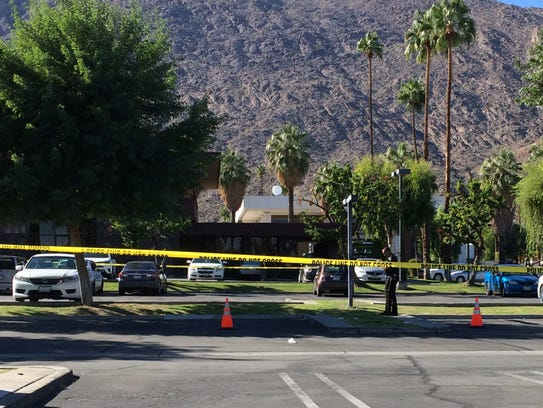 Police investigate the scene of an officer-involved