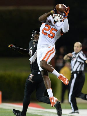 Clemson cornerback Cordrea Tankersley (25) intercepts a pass against Louisville on Sept. 17, 2015.
