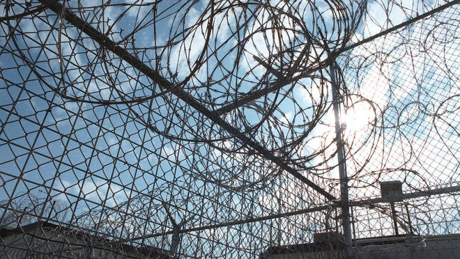 Razor wire at the maximum security Lowell Correctional Institution as seen in this 1998 file photo.