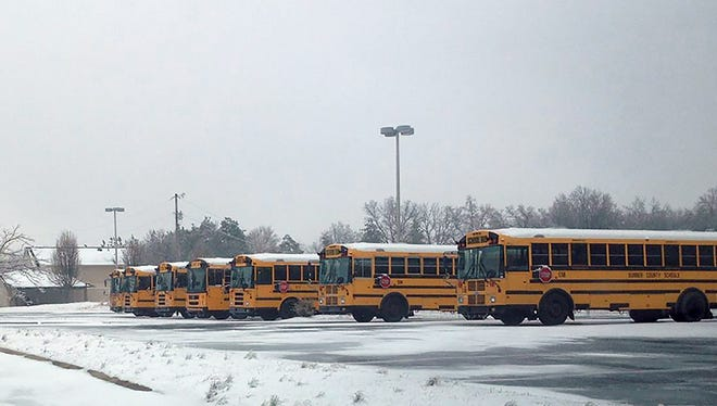 Sumner County school buses sit in a parking lot.