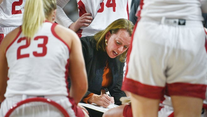 USD's head coach Dawn Plitzuweit talks to the team during a huddle during the game against SDSU Wednesday, Feb 21, in Vermillion.