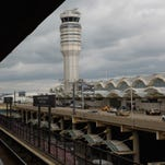 The control tower at Ronald Reagan Washington National Airport is seen from a Metro train stop on March 24, 2011, near Washington, D.C.