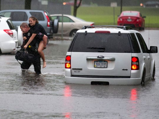 ISU Police Officer Doug Hicks rescues a woman from