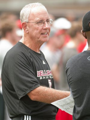 Bellarmine head basketball coach Scotty Davenport chatted along the sidelines at a University of Louisville open football practice.09 Aug 2015