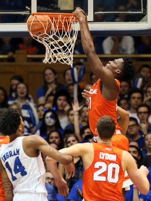 Syracuse Orange forward Tyler Roberson (21) dunks against the Duke Blue Devils in their game at Cameron Indoor Stadium.