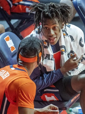Illinois guards Ayo Dosunmu, right, and Trent Frazier (1) chat on the bench during the second half of a blowout win against Chicago State in Champaign, Thursday, Nov. 26, 2020.