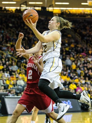Iowa's Samantha Logic (22) puts up a layup past Indiana's Jess Walter (2) during the second half of play at Carver-Hawkeye Arena in Iowa City on Sunday, February 15, 2015. The Hawkeyes improved to 21-4 (12-2) with the 81-64 victory over the Hoosiers, 14-11 (4-10.)