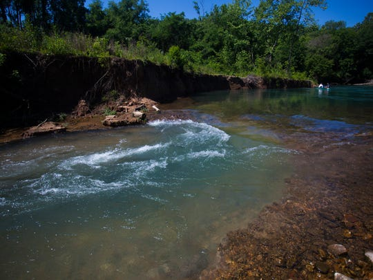 A deep pool creates fast-moving riffles and a perfect environment for rainbow trout in the federally protected Eleven Point River in southeast Missouri.
