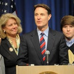 Susan Bayh was with her husband, Sen. Evan Bayh, and their twin sons, Nick (left) and Beau, when Bayh announced he would not seek re-election in 2010.