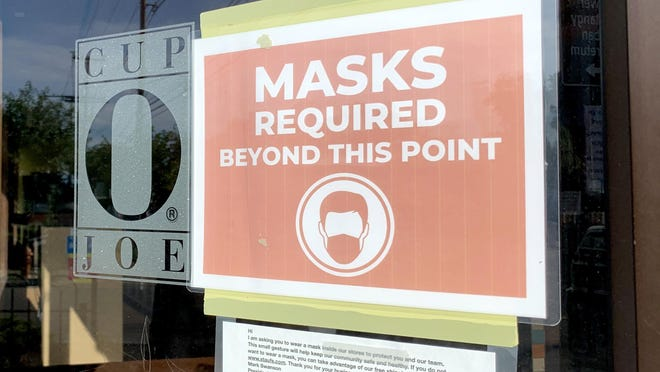 Signs outside Cup O Joe Coffee House in Clintonville inform customers of its mask rule. The shop also has markings at its checkout line to promote social distancing. There have now been 180,225 coronavirus cases in Ohio, according to the Ohio Department of Health.