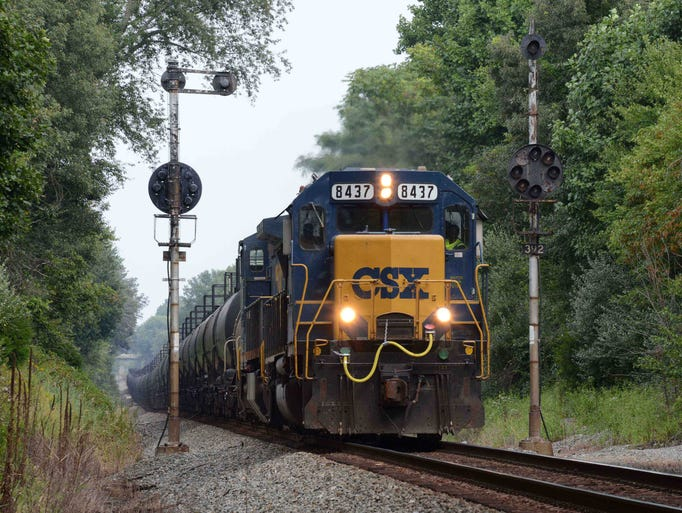 An empty CSX ethanol train passes near Newark on its way to the midwest in 2013.