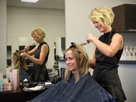 Michelle Meier works with client Chris Grimsley Tuesday, July 25, at Arbor Hair Studio in Waite Park. The studio is a member of the network of Green Circle Salons, which try to divert about 90 percent of what salons normally send to a landfill.