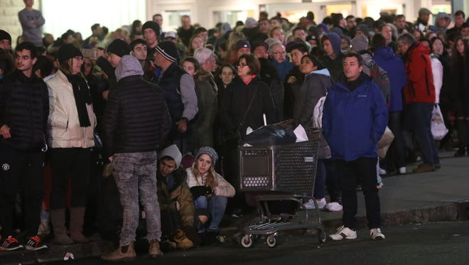 More than a thousand people were estimated to be on line for NJ Transit buses after the Jersey Gardens mall in Elizabeth was evacuated on one of the busiest days of the year.