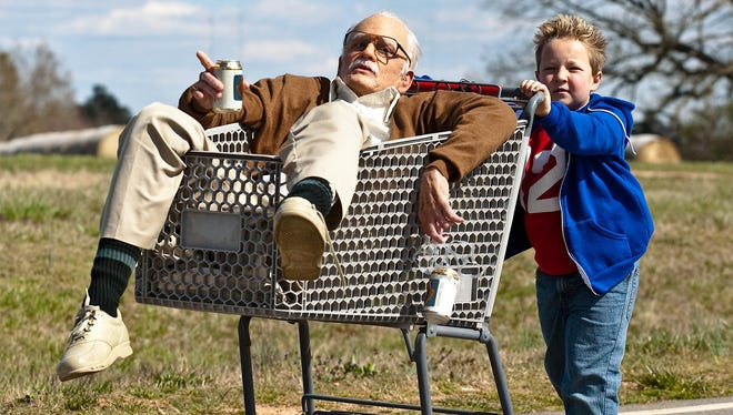 Johnny Knoxville left, is Irving Zisman and Jackson Nicoll is Billy in 'Jackass Presents: Bad Grandpa.'