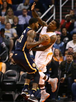 Phoenix Suns guard Eric Bledsoe (right) fouls Indiana Pacers forward Paul George in the second quarter at Talking Stick Resort Arena.