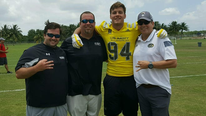 Gulf Coast senior tight end George Takacs (94) was told he's been selected to the U.S. Army All-American Bowl on Thursday, June 8, 2017, while at the Adidas Elite Three Stripe camp at FAU. Also pictured (L to R) Gulf Coast assistant coach Steve Hertz, Sharks head coach Pete Fominaya, and All-American Games vice president Steve Quinn.