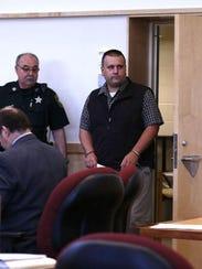 Fired Bennington County Cpl. Gary Harrington, right,
