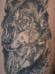 Police say Landon Bays, the man with this tattoo on