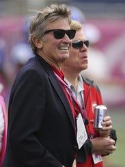 Former Florida coach Steve Spurrier smiles on the sideline