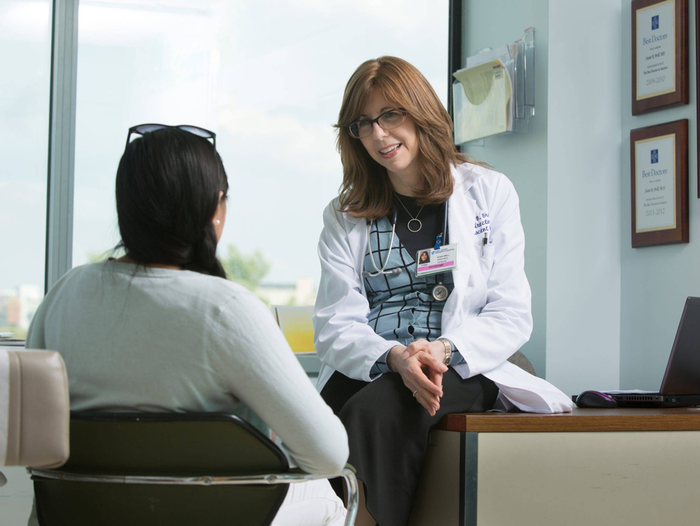 Dr. Susan Brill talks with a young patient.
