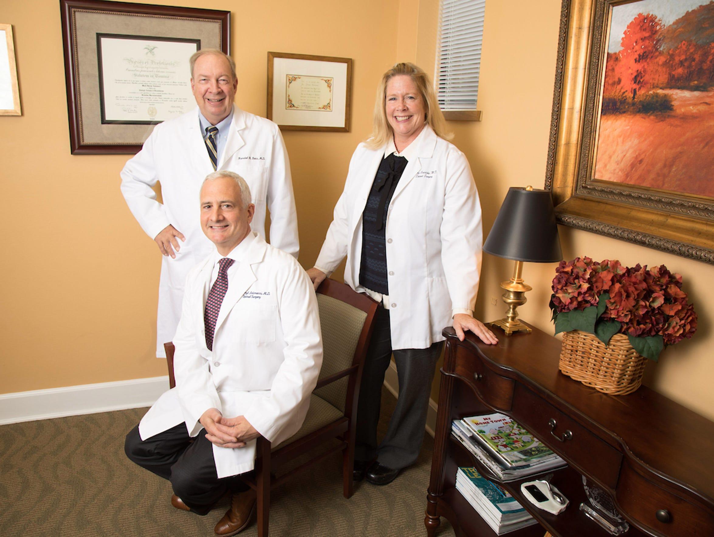 Doctors Darryl Antonacci (seated), Randal R. Betz and