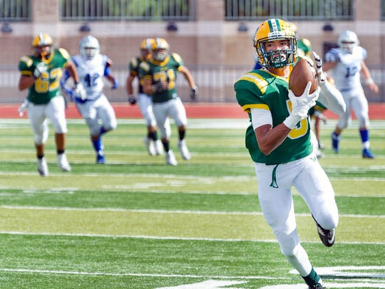 Mayfield wider receiver Steven Gay pulls in a pass for a huge gain Saturday afternoon against Carlsbad at the Field of Dreams.