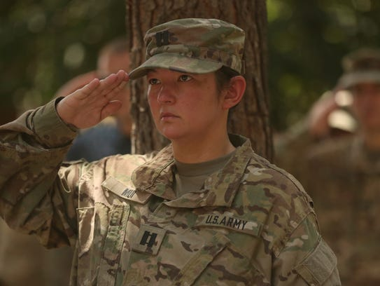 A U.S. soldier salutes during a change of command ceremony