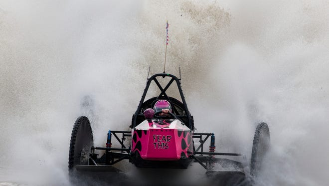 Fatal Attraction driver Bonnie Walsh, 57, crosses the finish line to win the Big Feature in 54.35 seconds during the Budweiser Winter Classic swamp buggy races at Florida Sports Park in Naples, Florida on Sunday, Jan. 29, 2017. This weekend was her first time racing since her husband and fellow swamp buggy driver, Terry ÒT-BoneÓ Walsh, died in March 2016.