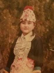 Mae when she was a girl wearing traditional Hmong garb