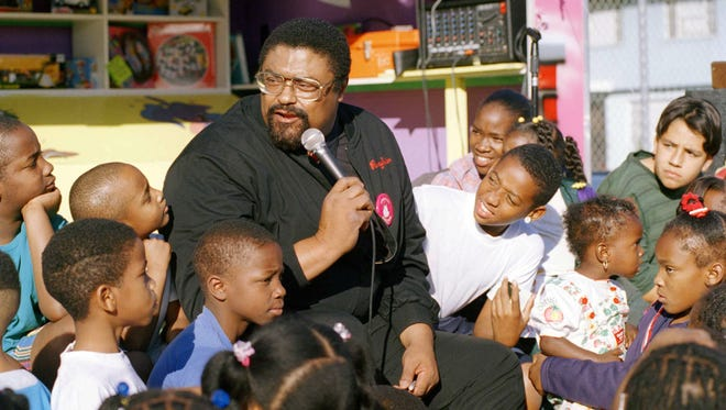 Rosey Grier has seemed to be preaching, entertaining and doing outreach his entire life. Here, he talks to children in a Compton, Calif. housing project in December of 1994 to benefit a charity offering aid to inner city kids.
