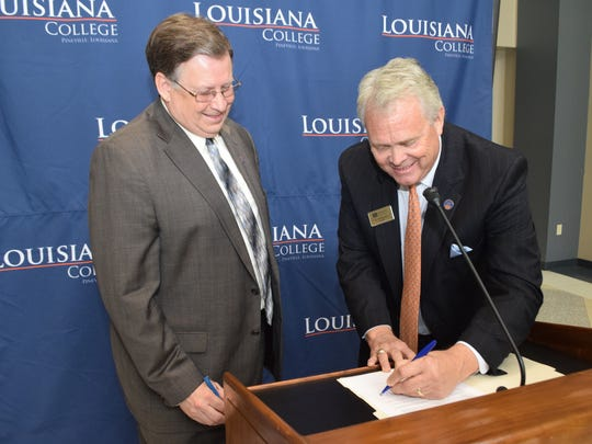 Louisiana Tech University President Les Guice (left) and Louisiana College President Rick Brewer sign a memorandum of understanding to allow qualified students to gain two bachelor's degrees in five years. Students will be able to complete a pre-engineering degree at LC before attending to Louisiana Tech.