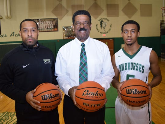 Peabody coach Charles Smith (center) poses with his