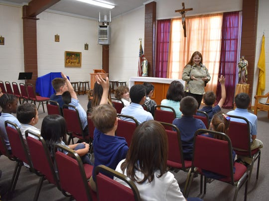 Undersheriff Lily Schnell talks to students about her time with the FBI and her current position in Otero County. Schnell said she hoped her presentation made the kids feel safe in the presence of law enforcement.