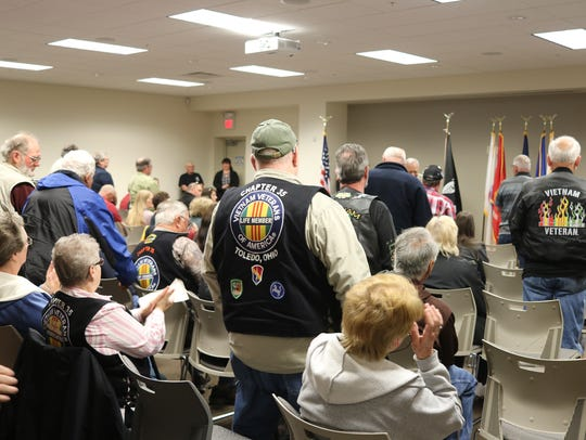 Local Vietnam War veterans who saw combat stand to