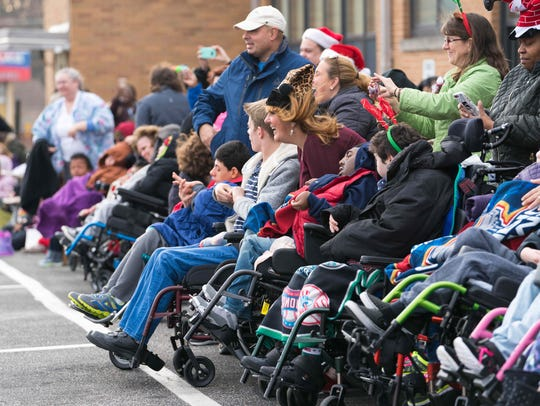 Students cheer as Santa arrives by helicopter Tuesday