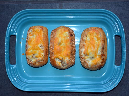 Creamy Mushroom-Stuffed Garlic Bread will please hungry football fans at your party.