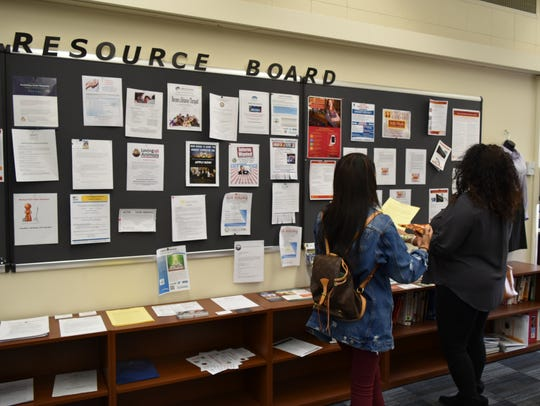 Students peruse COD's Career Center resource board,