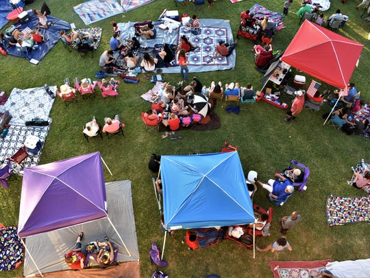 People set up picnics and tents all over the lawn near the San Angelo Fine Arts Center on July 3, 2018 for the 2018 July 3rd Pops Concert.